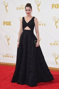 Amanda Peet with a Ferragamo clutch at the 2015 Emmys. See what all the stars wore to the ceremony.