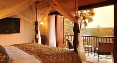 The David Livingstone Safari Lodge and Spa is a luxury resort located on the banks of the Zambezi River in Zambia, and only 10 kilometers from Victoria Falls. David Livingstone, Destin Hotels, Victoria Falls, Grand Homes, Vacation Destinations, Outdoor Pool, Good Night Sleep, Lodges, Cool Places To Visit