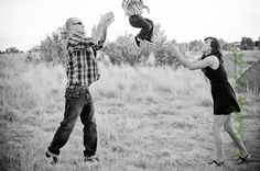 family photography.  son being tossed back and forth.  denver, colorado
