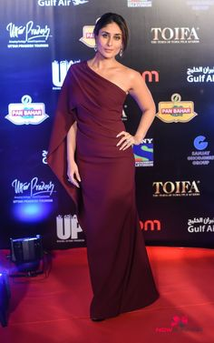 Kareena Kapoor rocked the TOIFA Award Night wearing maroon Asymmetric One Shoulder Gown, She finished off her look with light Make up and Bun Hairdo. Diana Penty, Kareena Kapoor Khan, Bollywood Stars, Bollywood Fashion, Bollywood Celebrities, Bollywood Actress, Celebrity Dresses, Celebrity Style, Karena Kapoor