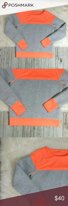 "Athleta Fuse Sweatshirt Colorblock Thumbholes Athleta Fuse Sweatshirt Size Medium Orange Gray Long Sleeve Thumb Hole Color Block  Measurements Length 24"" pit to pit 20"" Sleeve 29""  Pre Owned Athleta Sweaters Crew & Scoop Necks"