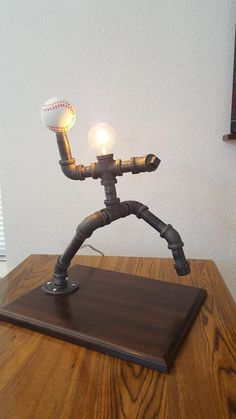 Baseball or softball pitcher pipe lamp Baseball Lamp, Baseball Crafts, Baseball Man Caves, Boys Baseball Bedroom, Pipe Lighting, Industrial Lighting, Industrial Pipe, Lampe Tube, Black Pipe