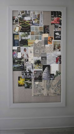"""We made this custom 80"""" high bulletin board: stapled old linen curtain panel onto homasote board, and framed with stock molding from Home Depot."""