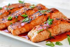 Broiled Salmon with Thai Sweet Chili Glaze Here's a quick weeknight recipe your family will love. Salmon fillets are quickly marinated in Th. Shrimp Recipes, Fish Recipes, Healthy Recipes, Seafood Dip, Thai Sweet Chili Sauce, Salmon Dishes, Salmon Food, Spicy Salmon, Baked Salmon
