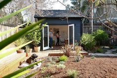 Backyard studio/cottage with gray paint and french doors