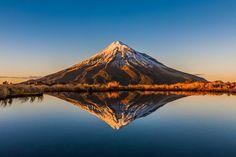 """Sunrise in New Zealand! ""Mount Taranaki"" by Ronnie Li. Reflection Photography, Landscape Photography, Nature Photography, Travel Photography, Wonderful Places, Beautiful Places, Beautiful Pictures, Parc National, National Parks"