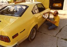 Car 54 - 13th race car  - 1977 Mazda RX3 8-13-79 -  The RX3 was the new car-to-beat in SSB and replaced the Alfa (seen in the garage).  This one was purchased locally in Salt Lake City.  Seen here with graphics being applied.