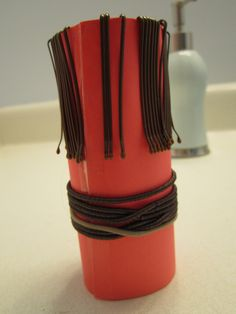 toilet paper roll used to organize bobby pins and hair elastics