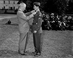 Cpl. Desmond T. Doss of Lynchburg, Va., receives the Congressional Medal of Honor from President Har... - Byron Rollins/AP Photo