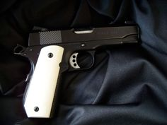 Ed Brown 1911 with bobbed tail mainspring housing.