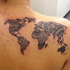 Henna style world map by this but on my thigh in brown ink.