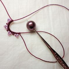 Yarnplayer's Tatting Blog: Tatting a mock ring with bead in center