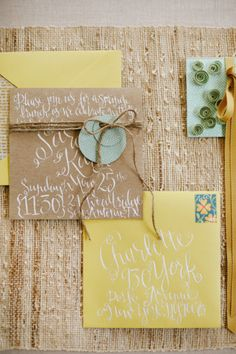 Rustic yellow invitations with white calligraphy and craft paper envelopes. #wedding #stationary.