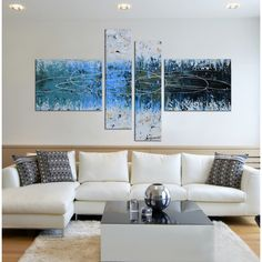 Show off your artistic side with this Hand-painted Hand-painted 'Snow Lake' 4-piece Gallery-wrapped Canvas Art Set. It is hand painted and can be hung horizontally. This piece of art will surely add a