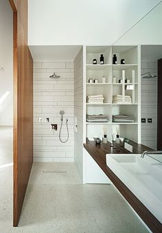 very tiny and narrow bathroom, but look how big it looks because of the open shower, continuous flooring, suspended vanity, and that marvelous huge mirror.