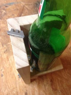 A few pieces of wood, some hardware, and a cheap bottle-cutting blade is all you need to build this effective bottle cutter.