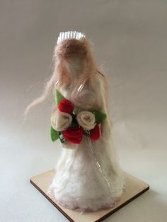 Marie the bride carries her bouquet of red and white roses. Adorned with beads throughout her hair and dress.Approx 5 inches tallPlease note this is not a toy, it is a decorative item, please be careful with children.Many hours of work go into creating each of my needle felted items. Each one is hand made using merino wool and shaped using special barbed felting needles.  Thank you for looking at my work if you have any questions please do not hesitate to contact me.Disclaimer... Please…
