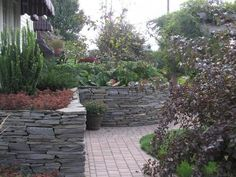 Stacked stone wall, love this!