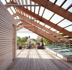 Rooftop Living Area With The Glass Roof And The Wooden Building Materials With Green View Sustainable house design http://seekayem.com