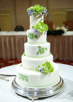 White, 5 Tiered, Round Wedding Cake with Green and Blue Flowers