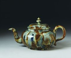 Teapot | agate ware, 1740-50. Staffordshire, England / Agate ware was expensive to make and had become obsolete by about 1760.