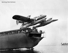Blohm & Voss Ha 139 taking off Schwabenland (former Schwarzenfels) catapult ship. The Blohm & Voss Ha 139 was a German all-metal inverted gull wing floatplane. With its four engines it was at the time one of the largest float-equipped seaplanes that had been built. Initially designed as mail/cargo aircraft for Deutche Lufthansa, on the outbreak of World War II, the planes were transferred to Luftwaffe and used for transport, reconnaissance and minesweeping work over the Baltic Sea.