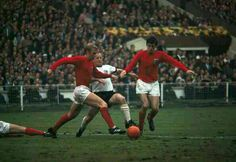 England 4 West Germany 2 in 1966 at Wembley. Bobby Moore and Martin Peters tackle Uwe Seeler in the World Cup Final.