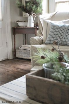 Living Room decor - rustic farmhouse style. Slipcovered sofa, enamel wash bin & pitcher and greenery for a winter decor.