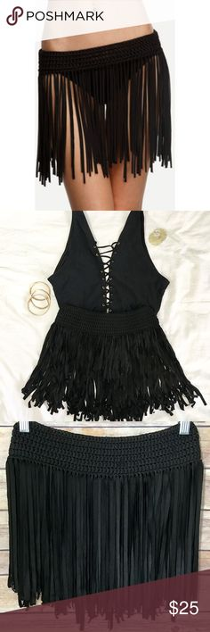 """Fringe Swim Skirt NWT A beautiful fringe skirt to wear over any type of bathing suit. The perfect addition to a chic summer swimsuit look. Soft, stretchy waistband for comfy fit on hips or at waist for a flattering, slimming silhouette. Completely waterproof- Can be worn swimming or just lounging by the pool. 11"""" across waist (can fit size small through extra large) 13"""" length. Brand new. No trades please! Offers welcome. Swim Coverups"""