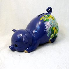 Hey, I found this really awesome Etsy listing at https://www.etsy.com/listing/176787103/ceramic-piggy-bank-violet-tulip-floral