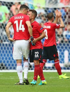 Granit Xhaka of Switzerland and Amir Abrashi of Albania embrace after the UEFA EURO 2016 Group A match between Albania and Switzerland at Stade Bollaert-Delelis on June 11, 2016 in Lens, France.