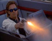 Burnett wears Revo's and carries a revolver.
