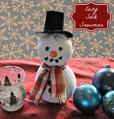 Making a Sock Snowman - this is really easy to make, my 4 year old hat a lot of fun with this one.