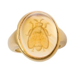 Citrine Gold Bee Intaglio Ring. This lovely hand carved citrine bee intaglio ring (by master Idar-Oberstein carver) looks to be suspended in time. It is set in 18 karat brushed gold. 16x12x8mm cabochon size. 21st century
