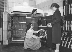 dinosaurspen:  Mathematician and pioneering software developer Phyllis Cady Johnson (right) and two unknown women working on an IBM calculating machine, date unknown. Johnson specialized in nuclear mathematics, first working at Lawrence Livermore Laboratory and later Oak Ridge National Laboratory, where she worked on the Manhattan Project and later went on to a career developing scientific software for the Atomic Energy Commission.