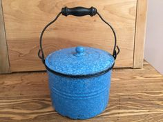 This vintage blue and white graniteware berry bucket or pail has a very pretty color and is complete with the matching graniteware lid. It is approx. 6 inches diameter and 4.5 in tall (about 5.5 in tall with lid). Has the original wire bail with wooden handle. It is heavy graniteware with white enamel interior. I think this blue is called the relish pattern. These old pails or buckets were originally used to pick berries and some mothers packed their childrens lunches in these old pails. It…