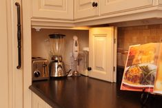 Hide small counter appliances behind cabinet doors on counter - cool idea!