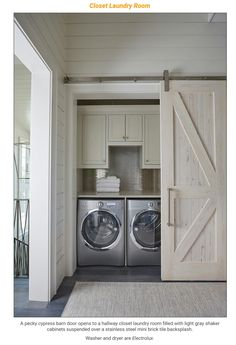 Beautiful compact laundry room with pecky cypress barn door.