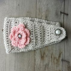 Crochet ear warmer in oatmeal with pink flower by MalindasDesigns