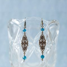 Victorian-style floral earrings with genuine Swarovski crystals in indicolite (teal blue)