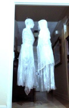 How to Make Ghosts Out Of Trash Bags And Packing Tape  http://www.iseeidoimake.com/how-to-make-ghosts-out-of-trash-bags-and-packing-tape/  See how to make realistic ghosts from trash bags and packing tape. These float around and move like real ghosts.