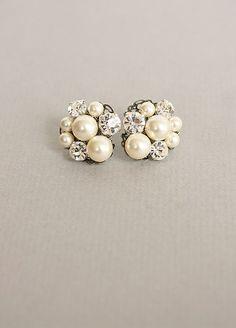 Classy pearl/diamond earring clusters