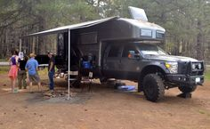 2014 EarthRoamer XV-LTS conquers the world, tailgates afterward Truck Camper Shells, Jeep Suv, Tent Camping, Camper Van, Monster Trucks, Tents, World, Vehicles, Teepees