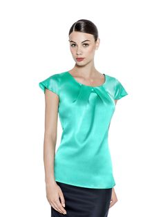 A gentle front folded fresh mint blouse with short sleeves. This stretch silk lightweight fabric has a keyhole buttoned back. Tuck into pencil skirt and tailored trousers alike, for instant effortless style. Fabric imported from Italy: 94% Silk 6% Elastan Washcare: Dry clean MADE IN EUROPE