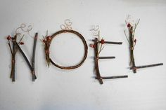 Noel twigs. Love this simple presentation.