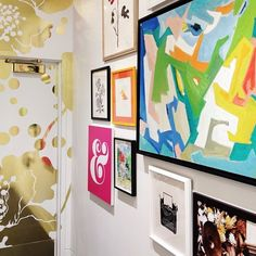 a great gallery wall at Kate Spade... And umm, what is that? Wallpaper!? Whatever it is, I want it.