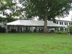 A tented wedding on the lawn. :)