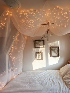Sprinkle magic with some string lights. #CanopyBed #KidsBedroom