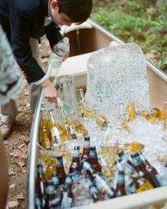 Beer bottles were kept cold (and accessible) in a canoe filled with blocks harvested from Squam Lake in New Hampshire.