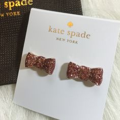 "Kate Spade Glitter Bow Earrings Kate Spade take a bow earrings. 12 karat gold plated metal with enamel. 14 karat gold filled posts. Approx. 11/16"" wide and 5/16"" drop. Rose gold glitter color. kate spade Jewelry Earrings"